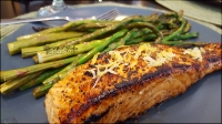 Lemon pepper salmon, topped with lemon zest; accompanied by roasted asparagus. (home-cooked)