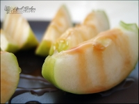 Granny Smith Apples, sliced and topped with caramel sauce.